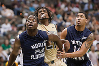 February 24, 2012:   North Florida Ospreys forward David Jeune (24) and guard Jimmy Williams Jr. (14) try to block out Jacksonville Dolphins forward Delwan Graham (21) during Atlantic Sun Conference action between the Jacksonville Dolphins and the North Florida Ospreys at Veterans Memorial Arena in Jacksonville, Florida. North Florida defeated Jacksonville 70-64.