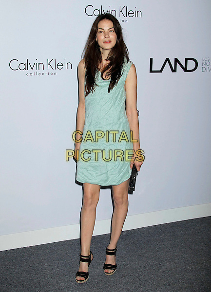 MICHELLE MONAGHAN .Attending Calvin Klein Collection and LOS ANGELES NOMADIC DIVISION present a celebration of L.A. Arts Month held at the Calvin Klein Store, Los Angeles, CA, USA, 28th January 2010..full length pale green sleeveless pastel dress crinkled black sandals clutch bag .CAP/ADM/MJ.©Michael Jade/Admedia/Capital Pictures