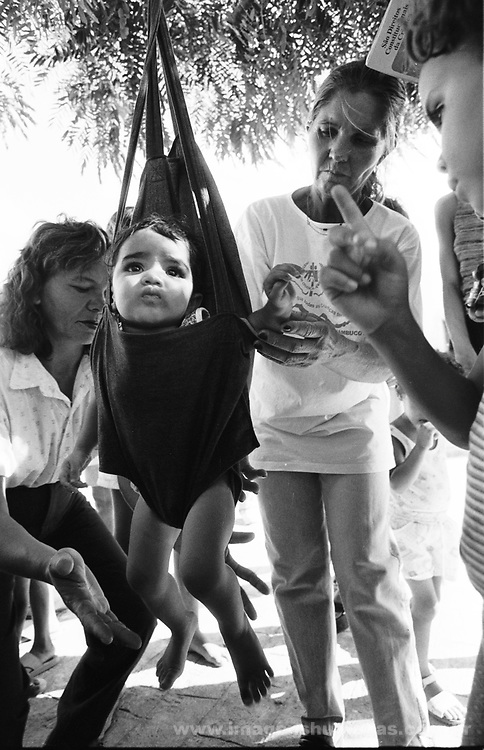 "Northeast Brazil..City:Afogados da Ingazeira; State: Pernambuco..Drought. NGO ""Pastoral da Criança"" ( Child Pastoral ) monitors children´s weight in a poor neighborhood."