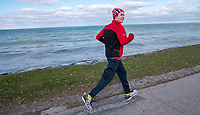 "Oliver Atar, of Brights Grove, jogs three to four times a week to keep in shape. ""I do it for myself, he said. He's seen running along Old Lakeshore Road in Brights Grove."