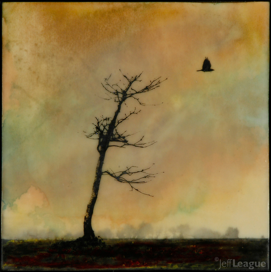 Bare tree and crow transferred to encaustic medium with golden sky.