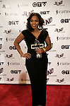 Divine Brown, winner of the 2009 Juno for R&B/Soul Recording of the Year, poses on the media wall, Saturday March 28th, 2009, at the Westin Bayshore Hotel in Vancouver.  (Scott Alexander/pressphotointl.com)
