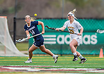 25 April 2015: University of New Hampshire Wildcat Attacker Kayleigh Hinkle, a Senior from Glenelg, MD, tries to outrun University of Vermont Catamount Defender Meghan Cobb, a Sophomore from Wilmington, DE, during game action at Virtue Field in Burlington, Vermont. The Lady Catamounts defeated the Lady Wildcats 12-10 in the final game of the season, advancing to the America East playoffs. Mandatory Credit: Ed Wolfstein Photo *** RAW (NEF) Image File Available ***