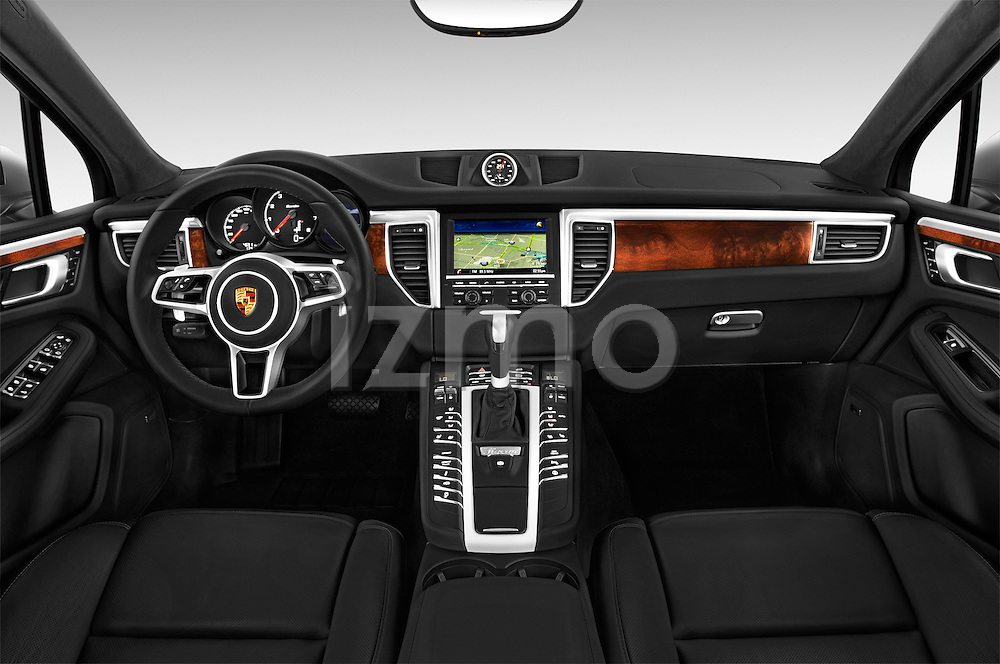 Stock photo of straight dashboard view of a 2015 Porsche Macan Turbo 5 Door SUV