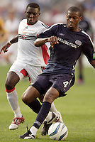 The New England Revolution's Avery John  attempts to keep the ball away from D.C. United's Freddy Adu. The New England Revolution and D.C. United finished in a scoreless tie in MLS play at Gillette Stadium, Foxboro, MA on Saturday August 28, 2004.