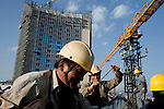 ADDIS ABABA, ETHIOPIA - NOVEMBER 17: Chinese construction workers build the new African Union Buildings on November 17, 2010 in Addis Ababa, Ethiopia. The building is built for free. Chinese companies are investing and working all over Africa and in Ethiopia they are mainly occupied with infrastructure projects around the country. Credit: Per-Anders Pettersson For The Wall Street Journal.