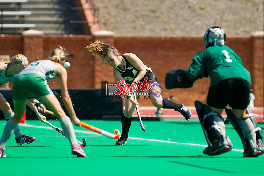 Holly Brown (24) of the Wake Forest Demon Deacons has her shot on goal blocked during first half action against the William & Mary Tribe at Kentner Stadium on September 15, 2013 in Winston-Salem, North Carolina.  The Demon Deacons defeated the Tribe 4-0.  (Brian Westerholt/Sports On Film)