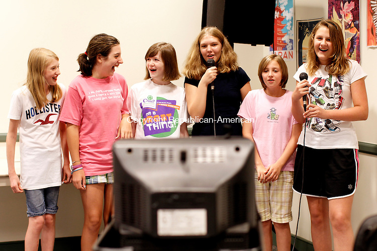"Southbury, CT- 13, August 2010-081310CM03 (From L-R) Ashley Del Vento, 12, Claire Bisch, 12, Colleen O'Sullivan, 13, Sheena Orten, 14, Kaitlyn Hirschfield, 12 and Savannah Moore, 12 sing Travie McCoy's ""Billionaire"" Friday evening at the Southbury Library.  The group was enjoying karaoke and refreshments during the end of summer party, which was held for kids who participated in the summer reading program.   --Christopher Massa Republican-American"