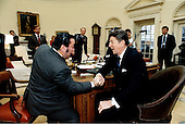 "United States President Ronald Reagan wins an arm wrestling bout with Dan Laurie, editor of ""Muscle Training Illustrated"".  The match took place in the Oval Office, Thursday afternoon, February 16, 1984..Mandatory Credit: Pete Souza - White House via CNP"