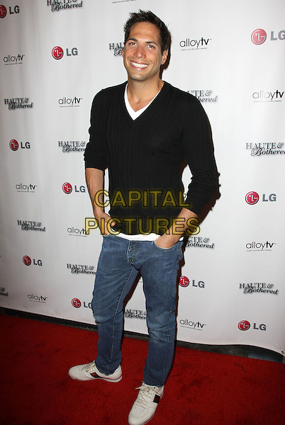 JOE FRANCIS.Alloy TV brings you The launch of Haute and Bothered Season 2 held At The Thompson Hotel Rooftop, Beverly Hills, California, USA..May 10th, 2010.full length black top jumper sweater jeans denim hands in pockets .CAP/ADM/KB.©Kevan Brooks/AdMedia/Capital Pictures.