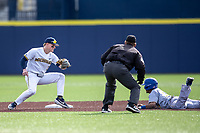 Michigan Wolverines shortstop Jack Blomgren (2) prepares to tag San Jose State Spartans baserunner Nico Malbrough (15) on March 27, 2019 in Game 1 of the NCAA baseball doubleheader at Ray Fisher Stadium in Ann Arbor, Michigan. Michigan defeated San Jose State 1-0. (Andrew Woolley/Four Seam Images)
