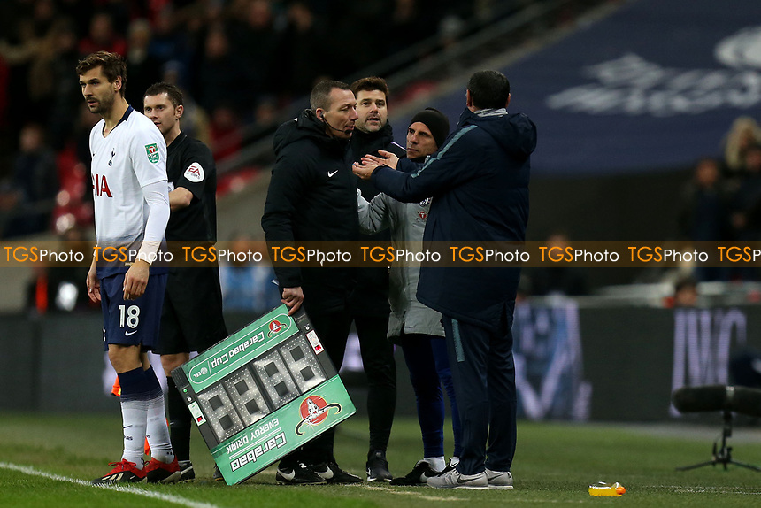 Chelsea manager Maurizio Sarri complains to the fourth official about the late Tottenham substitute as Tottenham Hotspur manager Mauricio Pochettino looks on during Tottenham Hotspur vs Chelsea, Caraboa Cup Football at Wembley Stadium on 8th January 2019