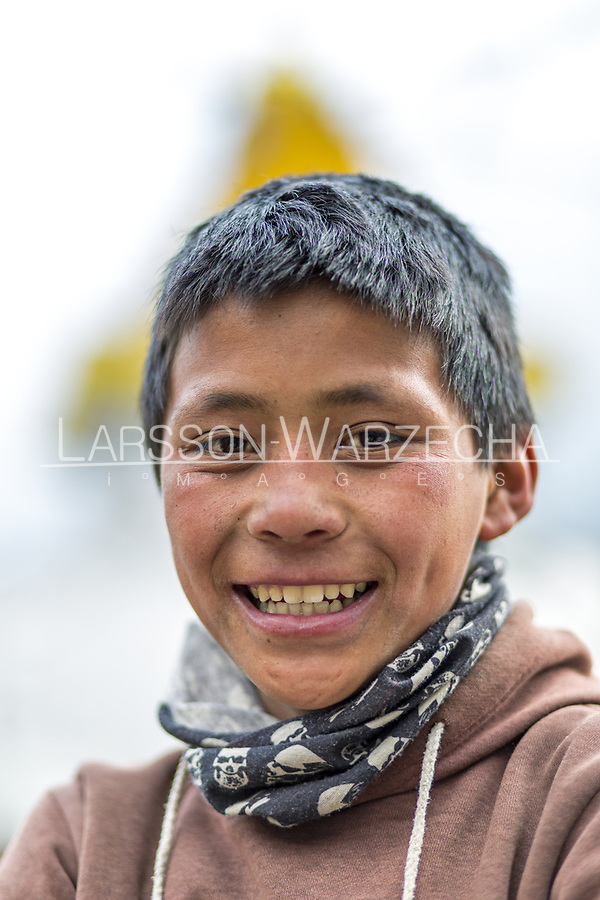 Portrait of Subash Tamang, 11 years old, (finished class 8). <br /> Weight: 30-40 kilo. (Doesn&rsquo;t know exactly.)<br /> Carrying: 15 kg of stone for the new path with prayer wheels in Namche.)<br /> Likes playing fotball.