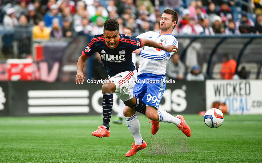March 21, 2015 - Foxborough, Massachusetts, U.S. - New England Revolution forward Juan Agudelo (17) reacts to getting tripped up with Montreal Impact forward Jack McInerney (99) during the MLS game between the Montreal Impact and the New England Revolution held at Gillette Stadium in Foxborough Massachusetts. The Revolution and the Impact ended the game tied 0-0. Eric Canha/CSM