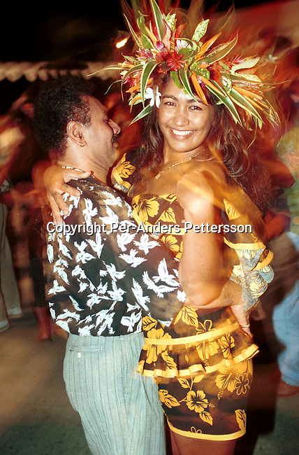 Local people dancing in traditional clothing during a Miss Bora Bora Beauty contest on April 29, 1997 on Bora Bora, a paradise island in French Polynesia. The Island is a playground for rich tourists and Hollywood stars as it provides total security and privacy. Most local people live of the tourism industry usually working in one of the luxury resorts. .Photo: Per-Anders Pettersson/ iAfrika Photos
