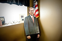 A George W. Bush cutout leans against the wall in a corner of the Coffee Station in Crawford, Texas, US, Wednesday, April 14, 2010. President Bush is known to stop at the coffee shop with staff and visitors...PHOTO/ MATT NAGER