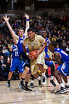Devin Thomas (2) of the Wake Forest Demon Deacons drives to the basket during first half action against the UNC Asheville Bulldogs at the LJVM Coliseum on November 14, 2014 in Winston-Salem, North Carolina.  The Demon Deacons defeated the Bulldogs 80-69  (Brian Westerholt/Sports On Film)