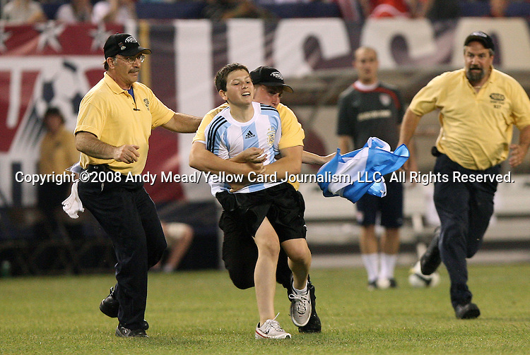 08 June 2008: A young Argentina fan is tackled by a security guard after a chase around the field at halftime. The Argentina Men's National Team and the United States Men's National Team played to a 0-0 tie at Giants Stadium in East Rutherford, New Jersey in an international friendly soccer match.