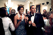 President Barack Obama and First Lady Michelle Obama dance while the band Earth, Wind and Fire performs at the Governors Ball in the East Room of the White House, February 22, 2009. .Credit: Pete Souza - The White House via CNP