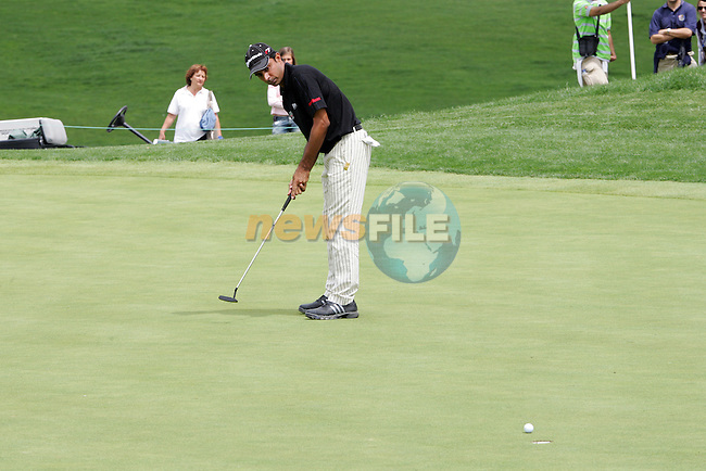 Jyoti Randhawa putts for birdie on the 11th hole in the 4th Round of the Open de Espana in Madrid...Photo NEWSFILE/Manus O'Reilly.(Photo credit should read Manus O'Reilly/NEWSFILE)....This Picture has been sent you under the condtions enclosed by:.Newsfile Ltd..The Studio,.Millmount Abbey,.Drogheda,.Co Meath..Ireland..Tel: +353(0)41-9871240.Fax: +353(0)41-9871260.GSM: +353(0)86-2500958.email: pictures@newsfile.ie.www.newsfile.ie.FTP: 193.120.102.198..