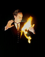MAGICIAN WITH FLASH PAPER<br /> (Variations Available)<br /> A Form Of Nitrocellulose<br /> When natural cellulose is nitrated using a combination of concentrated nitric and sulfuric acids, nitrocellulose is produced.  This nitrated materials are easily ignited and burn without ash