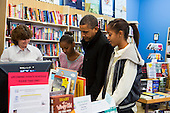 "United States President Barack Obama, center, and daughters Sasha, left, and Malia, right, shop at One More Page Books in Arlington, Virginia on Small Business Saturday, November 24, 2012..Credit: Kristoffer Tripplaar  / Pool via CNP..Pool Report 1: Motorcade left the South Lawn [of the White House] at 1:02 p.m. and arrived in Arlington, Virginia, at One More Page Books at 1:15 p.m. for an OTR (Off the Record) Small Business Saturday event with Sasha and Malia.  From the door of the small book shop, which the White House described as an ""independent, neighborhood bookstore,"" POTUS (President of the United States) could be seen holding up his BlackBerry, apparently looking up a title, as he spoke with shop owner Eileen McGervey. ""Preparation,"" the president said. ""That's how I shop.""  Wearing a dark windbreaker against the blustery weather outside, POTUS handed off a stack of about 10 books to the clerk -- pool was too far away to read titles -- (will send in a later report if we get them) and then shook hands with several employees. He then began to wander through the business with his daughters as pool was escorted out.  ""We're doing Christmas shopping,"" POTUS said to a question from the pool about the fiscal cliff. ""Happy Thanksgiving, folks.""  POTUS emerged about 10 minutes later to shake hands for a few minutes with two small groups that formed outside the shop on the sidewalk."