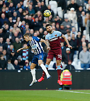 1st February 2020; London Stadium, London, England; English Premier League Football, West Ham United versus Brighton and Hove Albion; Ryan Fredericks of West Ham United wins an aerial battle with Leandro Trossard of Brighton and Hove Albion