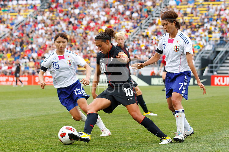 14 MAY 2011: USA Women's National Team midfielder Carli Lloyd (10) takes the ball through Japan National team Aya Samesh and Kozue Ando during the International Friendly soccer match between Japan WNT vs USA WNT at Crew Stadium in Columbus, Ohio.
