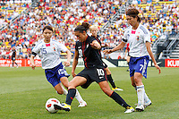 14 MAY 2011: USA Women's National Team midfielder Carli Lloyd (10) takes the ball through Japan National team Aya Samesh and Kozue Ando during the International Friendly soccer match between Japan WNT vs USA WNT at Crew Stadium in Columbus, Ohio.