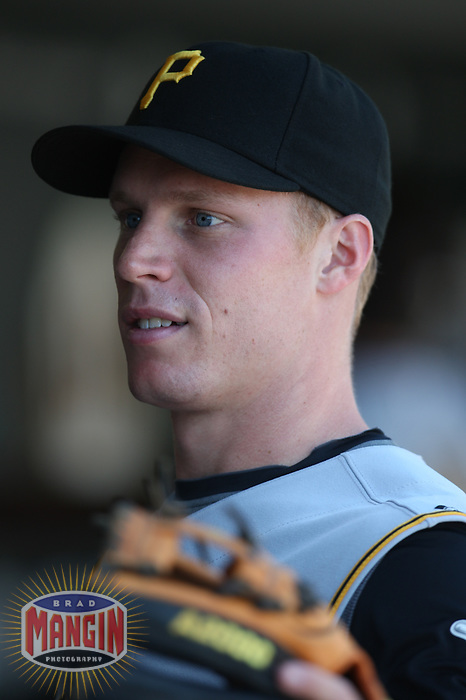 SAN FRANCISCO - SEPTEMBER 7:  Brian Bixler of the Pittsburgh Pirates gets ready in the dugout before the game against the San Francisco Giants at AT&T Park in San Francisco, California on September 7, 2008.  The Giants defeated the Pirates 11-6.  Photo by Brad Mangin