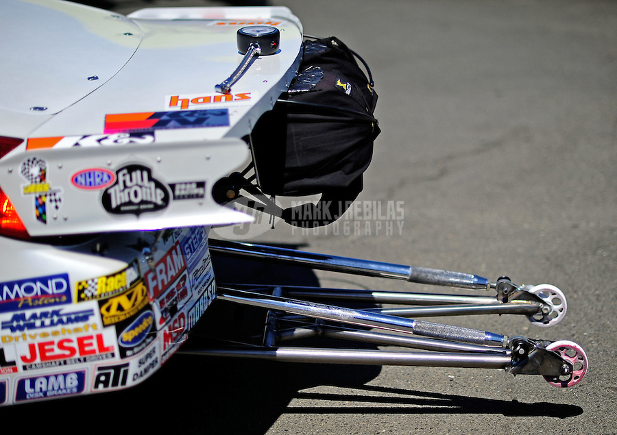 Jul. 17, 2010; Sonoma, CA, USA; Detailed view of the parachutes and wheelie bars on an NHRA pro stock car during qualifying for the Fram Autolite Nationals at Infineon Raceway. Mandatory Credit: Mark J. Rebilas-