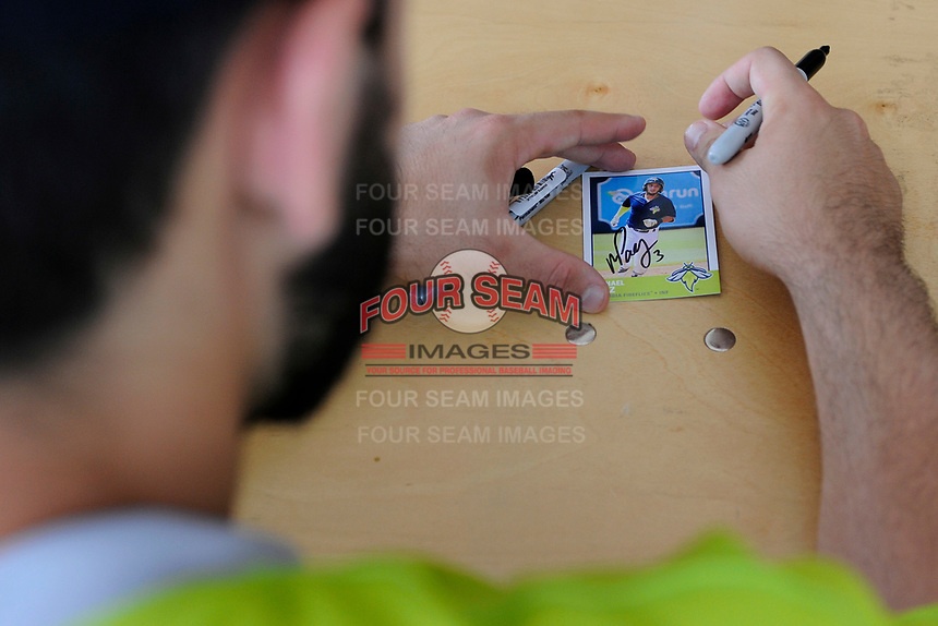Michael Paez (3) of the Columbia Fireflies signs at the South Atlantic League All-Star Game Fan Fest on Tuesday, June 20, 2017, at Spirit Communications Park in Columbia, South Carolina. The game was suspended due to rain after seven innings tied, 3-3. (Tom Priddy/Four Seam Images)