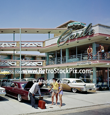 Caribe Motel, Atlantic City, NJ. Porter helping a couple with their bags.
