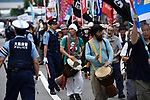 JUNE 28, 2019 - Protestors play drums and hold signs while marching during the G20 Summit in Osaka, Japan. (Photo by Ben Weller/AFLO) (JAPAN) [UHU]