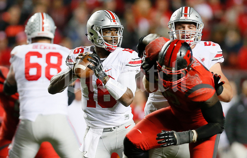 Ohio State Buckeyes quarterback J.T. Barrett (16) looks for an open passer as Ohio State Buckeyes offensive lineman Billy Price (54) blocks during the college football game between the Rutgers Scarlet Knights and the Ohio State Buckeyes at High Point Solutions Stadium in Piscataway, NJ, Saturday night, October 24, 2015. The Ohio State Buckeyes defeated the Rutgers Scarlet Knights 49 - 7. (The Columbus Dispatch / Eamon Queeney)