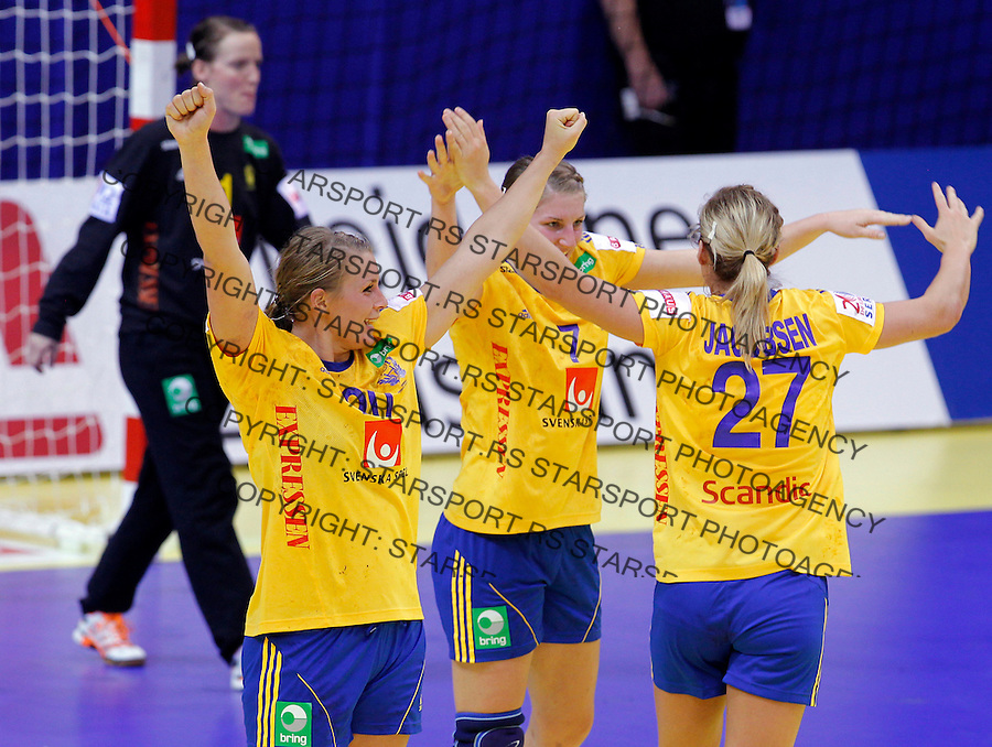NIS, SERBIA 4/12/2012/ Isabelle Gullden, Linn Blohm and Sabina Jacobsen of Sweden celebrate during Women`s European Handball Championship match between France and FYR Macedonia (FYROM) in Cair arena in city of Nis in southern Serbia on  December 4, 2012 Credit: PEDJA MILOSAVLJEVIC/SIPA/