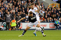 Tom Bradshaw of Millwall shields the ball from Mateusz Klich of Leeds during Millwall vs Leeds United, Sky Bet EFL Championship Football at The Den on 5th October 2019