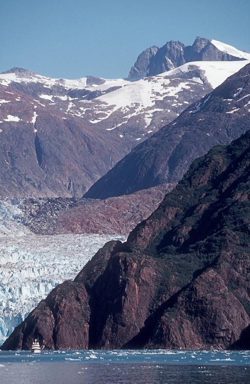 Alaska, Tracy Arm, A Luxury Cruise Ship is dwarfed by the size of Sawyer Glacier, Southeast Alaska, Inside Passage,.