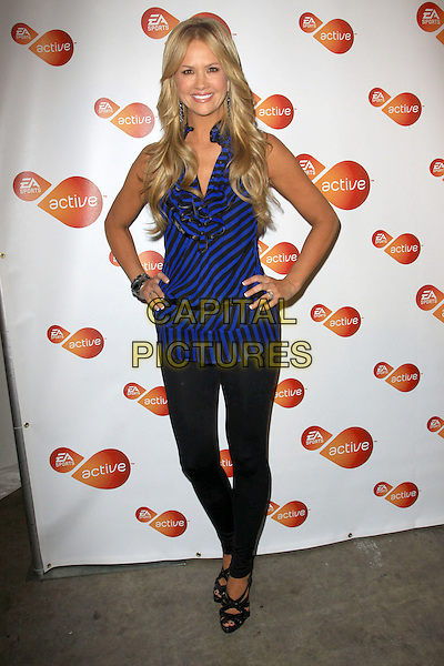 NANCY O'DELL.Active For Life event and auction to benefit the March of Dimes Arrivals held At The Warner Drive Studio, Culver City, California, USA..January 8th, 2009.full length black leggings blue purple striped stripes top hands on hips .CAP/ADM/KB.©Kevan Brooks/AdMedia/Capital Pictures.