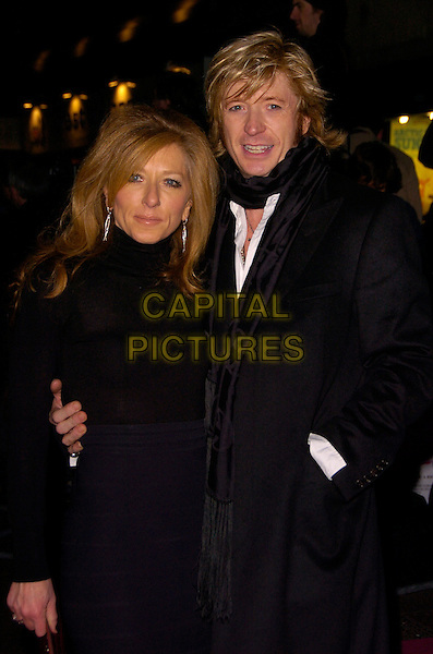 "KELLY HOPPEN & NICKY CLARKE.The UK Film Premiere of ""St. Trinian's"" held at the Empire Leicester Square, London, England..December 10th 2007.half length black scarf jacket coat top skirt couple hand in pocket .CAP/CAN.©Can Nguyen/Capital Pictures"