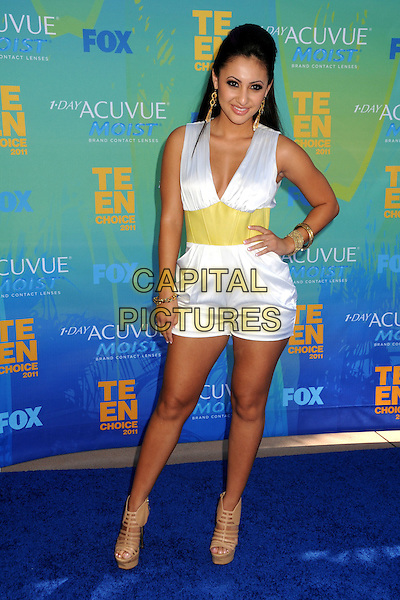 Francia Raisa.2011 Teen Choice Awards - Arrivals held at Gibson Amphitheatre, , Universal City, California, USA..August 7th, 2011.full length white sleeveless shorts playsuit yellow waistband beige ankle strappy sandals shoes hand on hip.CAP/ADM/BP.©Byron Purvis/AdMedia/Capital Pictures.