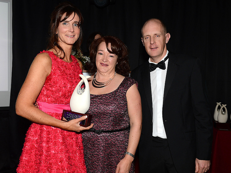 Yvonne Brady and Siobhan O'Dwyer from EVB Sports receive the Small Business award from Pat Gray representing sponsor Irish Cement at the Business Excellence Awards in Earth Night Club at the Westcourt Hotel. Photo:Colin Bell/pressphotos.ie
