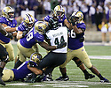 SEATTLE, WA - SEPTEMBER 14: Hawaii's 44) Hekili Keliiliki (RB) runs into a wall of Washington defensive players during the college football game between the Washington Huskies and the Hawaii Rainbow Warriors on September 14, 2019 at Husky Stadium in Seattle, WA. Jesse Beals / www.Olympicphotogroup.com