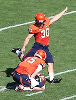 Virginia quarterback Matt Johns (15) Virginia punter Alec Vozenilek (30) Ball State defeated Virginia 48-27 during an NCAA football game Saturday Oct. 5, 2013 at Scott Stadium in Charlottesville, VA. Photo/Andrew Shurtleff