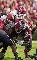 Hawgs Illustrated/BEN GOFF <br /> Hjalte Froholdt (right), Arkansas offensive lineman, blocks Javon Kinlaw (99), South Carolina defensive lineman, as Kinlaw and Keir Thomas (5), South Carolina defensive lineman, tackle David Williams, Arkansas running back, Saturday, Oct. 7, 2017, at Williams-Brice Stadium in Columbia, S.C.