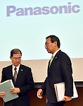 April 28, 2015, Tokyo, Japan - Kazuhiro Tsuga, right, president of Japan's Panasonic Corp., arrives for a news conference at its Tokyo head office to present its earnings on Tuesday, April 28, 2015. For the current fiscal year through March 2016, the Japanese electronics expects its group net profit to edge up 0.3 percent to 180 billion yen.  (Photo by Natsuki Sakai/AFLO) AYF -mis-