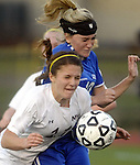 (Worcester Ma 111613) Newburyport 11, Carly Brand and Granby 10, Tara Mikalchus, in a hard charge  after the ball in the second half, during the MIAA State Girls Soccer Division Three final, between Newburyport High and Granby High, Newburyport won the game 1-0, Saturday at Foley Stadium in Worcester. (Jim Michaud Photo) For Sunday