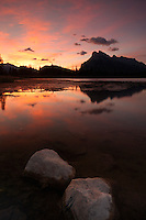 Glorious, colorful sunrise at vermillion lakes in Banff. Mount Rundle, Tunnel Mountain in the background, reflection in the lake surface