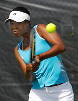 Florida International University senior Nikkita Fountain returns a shot during one of her matches on the final day of the FIU Spring Invitational, January 19-21, 2007 at Miami, Florida.  With her doubles partner, Paula Zabala, Fountain defeated the University of South Florida doubles pairing of Ann-Marie Modric and Gabriela Duch, 8-3.  Fountain didn't fare as well in her singles match against the University of Miami's Gina Sabatino, losing in straight sets, 6-1, 6-1.