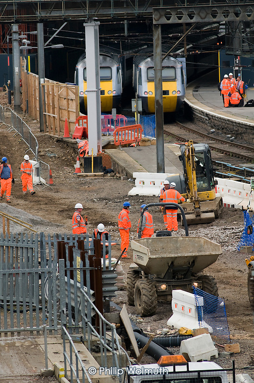 Construction workers at King's Cross station, London.